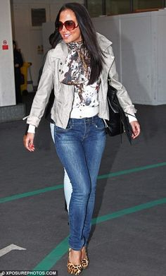 Celebrity Scarf Watch: Tulisa Contostavlos arriving at Heathrow Airport, wearing an animal print scarf.
