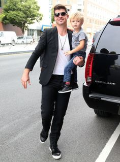 Robin Thicke and his adorable son Julian Fuego Thicke arrive at the Barclay Center. How cute are their matching black sneakers with white soles?