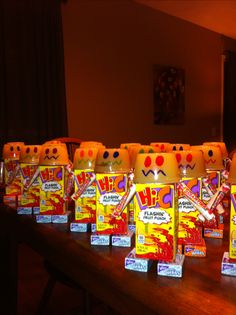 Build-A-Robot with a juice box, applesauce, smarties and mini boxes of raisins.. so cute for in a lunch box or even a treat for a school party or robot themed birthday!