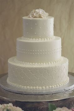 fondant white wedding cake with dots and quiltedpattern
