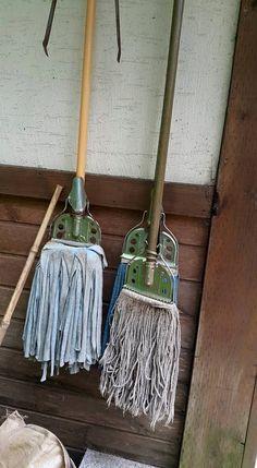 3 mops hang upside down.