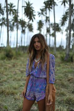 Sexy modern hippie purple onsie with gypsy inspired necklace and boho fringe purse for some festival style. For the BEST Bohemian fashion trends of 2015 FOLLOW > https://www.pinterest.com/happygolicky/the-best-boho-chic-fashion-bohemian-jewelry-gypsy-/ < now