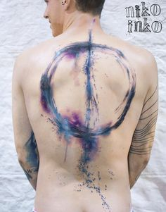 circle blue and purple watercolor tattoo by niko inko