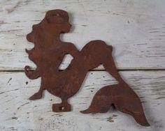 Rusty metal sitting mermaid