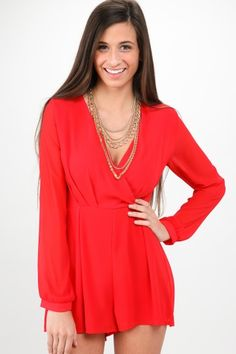 Must have, red long sleeve romper with a wrap bodice! Want, need, love! Repin if you love it as much as we do!