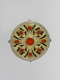 Pectoral ornament, silver, fire gilded with engraving/punching, stamped bead and twisted wired and openwork decoration and table cut carnelians, Central Asia or Iran, late 19th-early 20th century
