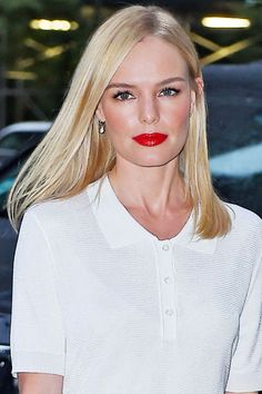 Welcome in the shiny new season with a glossing treatment, a glow-inducing facial and patent red lipstick like Kate Bosworth does here. See all our favorite fall beauty styles: