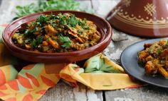 Moroccan Garden Vegetable Tagine // A traditional Moroccan vegetarian dish served with sweet potatoes, eggplant, and garden vegetables.This gluten-free and vegan tagine will have you in love after one bite! Veggie Dishes, Veggie Recipes, Whole Food Recipes, Cooking Recipes, Healthy Recipes, Tasty Snacks, Slow Cooking, Savoury Dishes, Healthy Dinners