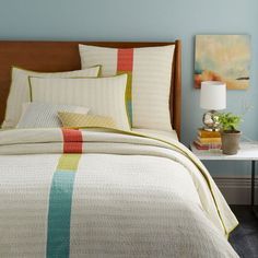 Made of 100% cotton by skilled artisans in India, the Kantha Coverlet is a lightweight layer of tone and texture. Vibrant stripes are hand stitched across the neutral surface for a welcome splash of color.