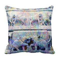 Colorful Elephants India throw pillow featuring carved elephants, horses and decorative artwork on a temple in Udaipur Rajasthan, India. Textured with the colors of the spring Holi festival, and a solid periwinkle blue reverse.