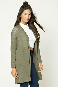A ribbed knit cardigan featuring a longline silhouette, open-front, and long sleeves.