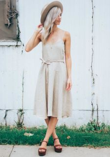This little frock is perfect for any occasion. Each dress is handmade with quality Linen.   Comes with a matching tie around the waist and the straps can be converted from criss cross to straight to fit your personal style.  All pieces handmade in Austin Texas by Curry Beth