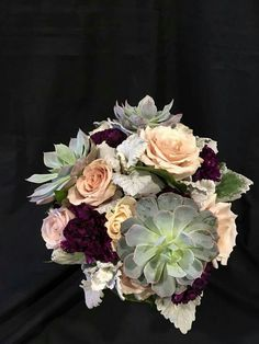Succulents and champagne roses - I like the succulents, not the roses