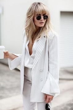 {Striped white suit.}