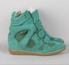 SNEAKERS BURT GREEN / ISABEL MARANT 425,00 € TAX INCL. Isabel Marant Sneakers. Beautiful green nubuck and leather hankle sneakers, with 5 cm hidden heel. Rubber sole. http://eshopping.lesappartementsdejuju.com/en/sneakers/1184-b.html