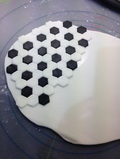 Making sugar paste football pattern for football cupcake toppers
