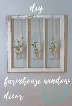 DIY farmhouse window decor. Glass jars hanging with jute/string and greens. Simple, natural look.