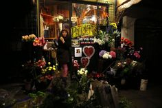 Patricia Lanao waits for customers at her flower shop on Columbus Avenue in North Beach. Photo: Scott Strazzante, The Chronicle
