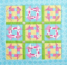Make a pretty spring quilt using pastel and floral fabrics. Fussy-cut sashing squares add a seasonal accent.