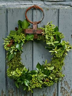 LC is on the hunt for a rusty old ring like this to adorn a wreath of green foliage....love the look!