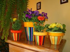 Striped flower pots - love the colours Flower Pot Art, Flower Pot Crafts, Clay Pot Crafts, Painted Plant Pots, Painted Flower Pots, Cactus Clipart, Clay Pot People, Plant Projects, Terracotta Pots