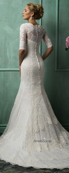 I love the lace, skirt, and length of the train! Amelia Sposa 2014 Wedding Dresses - Belle the Magazine . The Wedding Blog For The Sophisticated Bride
