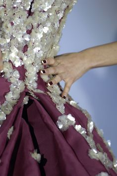 Dior details: I like the way a solid covering of sequins at the tip flares into more scattered on on the skirt.