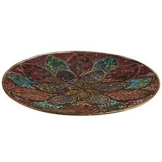 Our mosaic platter, which boasts an extravagant bloom, is handcrafted and hand-embossed, so no two are exactly alike. Sit it on a hall table or the mantel where it can fully blossom. Like many of our incredible discoveries, this decorative plate is found only at Pier 1.