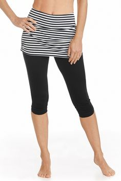 """Want leg coverage but not 100% sold on our tights? Our Skirted Swim Capris have a contoured athletic fit and ruche skirt top sure to flatter your figure. Made of our aqua SUNTECT®️ that""""s quick to dry and chlorine/salt resistant, this capri works on land or in water. Grip elastic in back prevents back from slipping. We've added a pocket inside the front for keys too."""