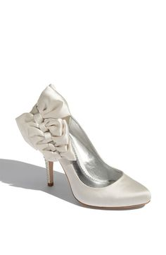 I'm obsessed with wedding shoes. These Bournes are beautiful and also come in black, light brown and red. Notice the rhinestone detailing on the heel. And the bows!!! These make for great pictures!