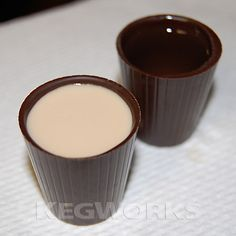 Vanilla Cream Chocolate Shooters  Ingredients per serving    1 Belgian chocolate shot cup  ½ oz amaretto liqueur  ½ oz Amarula cream liqueur  1 oz vanilla vodka    Layer each of the spirits into your chocolate shot cup in order (amaretto, Amarula, vodka) and enjoy!