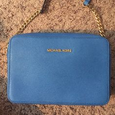 MICHAEL KORS BAG Brand new BEAUTIFUL Michael Kors jet set travel crossbody blue leather bag with blue and gold chained strap. I do not have the tags but it was never used! Still have packaging inside! (As seen in one of the photos). Measurements; 9.5X7X2.5 Michael Kors Bags Crossbody Bags