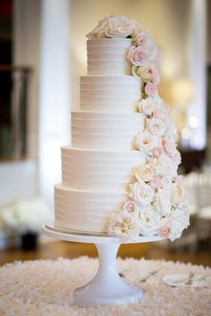 white five tier wedding cake with cascading roses: Bridal Bliss Wedding