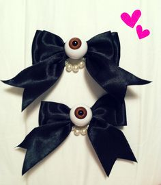 2 Eyeball Bow Clips with Glass Pearls spooky cute pastel goth creepy. $13.00, via Etsy.