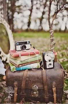 Old camera's and books on trunk, pretty pic!