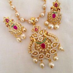 CZ and ruby stone pendant set Code : PS 373 Price: Rps. Whatsap to 09581193795 for order processing Indian Jewelry Sets, Indian Wedding Jewelry, Bridal Jewelry, Indian Bridal, Pearl Jewelry, Antique Jewelry, Jewelery, Gold Jewellery Design, Diamond Jewellery