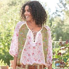 """Pastoral prints, splashed with petite bouquets, in pink and green silk chiffon shape our airy top for spring and summer. Lace-up neckline, lacy trim, elasticized sleeves and blouson hem with drawstring ties. Dry clean. Imported. Exclusive. Sizes XS (2), S (4 to 6), M (8 to 10), L (12 to 14), XL (16). Approx. 24-1/4""""L."""