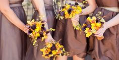 dark plum and yellow bouquets, with orchids, billy balls, ranunculus, callas and more...
