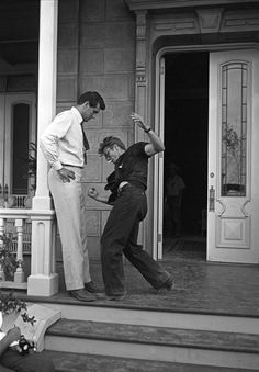 """1955– Rock Hudson and James Dean rehearsing a scene from """"Giant"""" after Jett Rink strikes oil on Little Reata. """"Rock and Jimmy were a bit jealous of each other.Jimmy was jealous of Rock because Rock had all the good dialogue, and Rock was jealous of Jimmy becauseEast of Eden had just been released and Dean was getting all the attention from the media. They never had words, but you could feel the jealousy. [Movie GIANT, 1955, Marfa, Texas]"""