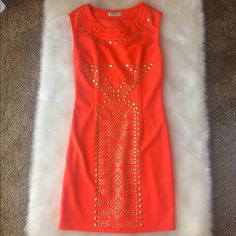 "🌟Orange Bodycon Studded Dress🌟 Sooo sad this did not fit me😢 vibrant orange color. Gold tone studs on front. Size small, fits more like an XS. Total length approx 32"" bust measures 15"" across while laying flat. Clean🚿 smoke free home🚫🚬🚫 plenty of pics📷 🔹Please ask questions if necessary! No returns and all sales final. 🔹 fast ship📦 ❌NO TRADES❌NO HOLDS❌Thanks!😊😊 Dresses"