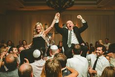 Jewish weddings and the importance of the role of parents and family / The hora / Jewish Dance / http://www.smashingtheglass.com/jewish-weddings-importance-role-parents-family/
