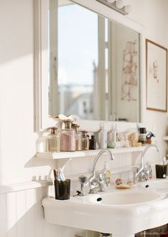 love the simple shelf under the mirror.