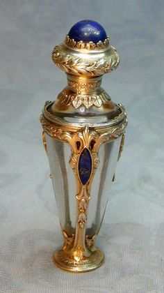 "French perfume bottle c1880, cast in chased sterling silver with inlaid Lapis Lazuli lozenges and button on the lid. 3.5""h."