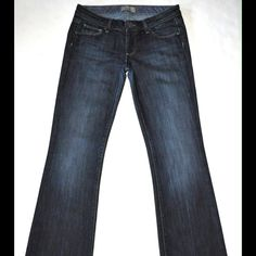Paige Denim Laurel Canyon low rise boot cut These jeans have been a favorite of mine...when they fit. Gently used but excellent condition! * Laurel Canyon Low Rise Boot Cut * Gorgeous dark blue indigo wash with cool factory fading * Zipper front with silver tone branded button closure  * 3 front (including small coin pocket) and 3 back pockets including small hidden one (inside back right pocket) * Leg hems have a little wear on the back as seen in picture. The front has no wear on hem…