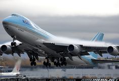 Korean Air Cargo Boeing 747-4B5/ERF(SCD) departing Anchorage with some wing condensation