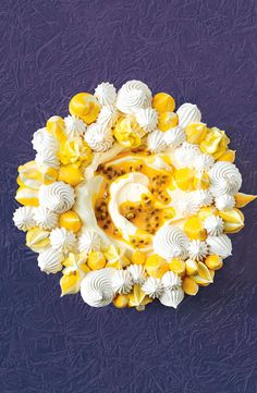 Watch jaws drop when this golden meringue wreath filled with passionfruit curd is brought to the table. Pavlova Cake, Meringue Pavlova, Meringue Desserts, Meringue Food, Trifle Desserts, Macarons, Gourmet Recipes, Dessert Recipes, Gourmet Foods