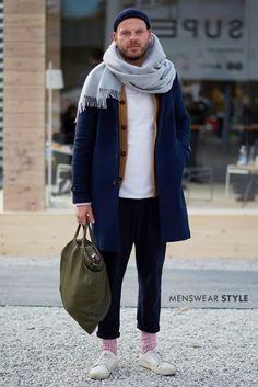 A cool winter hipster style we captured during Pitti Uomo featuring a grey scarf and fisherman beanie.