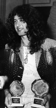 Jimmy Page with Awards for Led Zeppelin