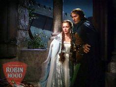 "Olivia de Havilland and Errol Flynn as Maid Marian and Robin Hood in ""The Adventures of Robin Hood"" (1938)"