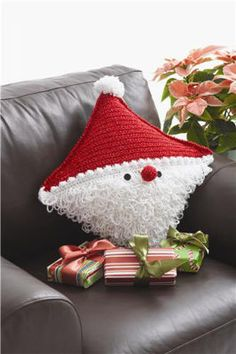 Bernat Santa Pillow. So cute! Pin leads to Michael's website with the instructions on how to crochet and make this little guy!